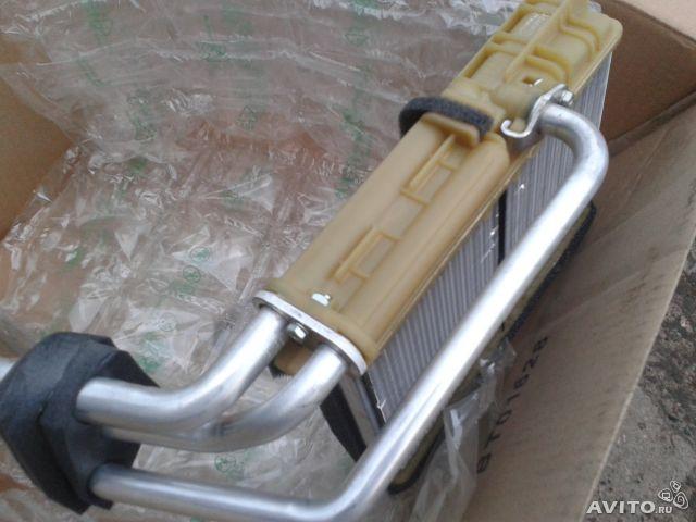 6 снимаем хомуты и трубки, с корпуса термостата